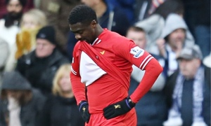 Liverpool's Kolo Touré looks dejected after his mistake led to West Bromwich's Albion's equaliser